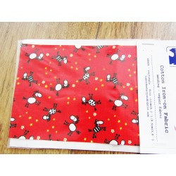 Iron-on  repair fabric - horsies on red